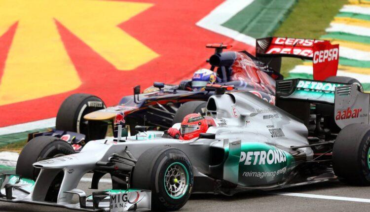 Daniel-Ricciardo-alongside-Michael-Schumacher-planetF1.jpg
