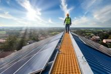 technician-on-solar-panel-roof_Pramote-Polyamate_Getty.jpg